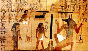 "A section of the Egyptian Book of the Dead written on papyrus showing the ""Weighing of the Heart"" in the Duat using the feather of Maat as the measure in balance."
